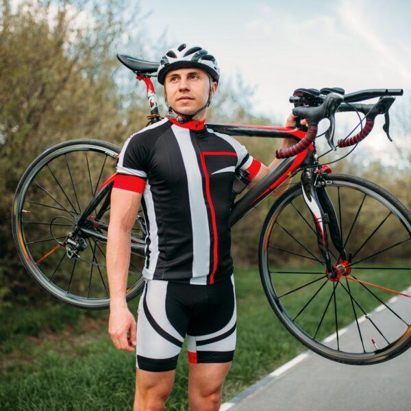 Bycyclist keeps the bike on shoulder after biking